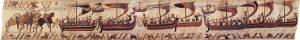 """Гобелен """"Норманский флот Вильгельма-Завоевателя"""". В ладьях — норманы со своими лошадьми. Всадники верхом, вероятно, Вильгельм и его свита"""