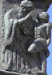 Один из барельефов: Гилель учит язычника смыслу всей Торы, пока тот стоит на одной ноге.